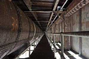 Catwalk under steel arch span and water pipe, 2009